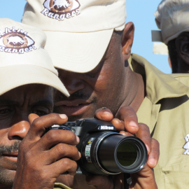 Rhino Rangers are shown holding a camera