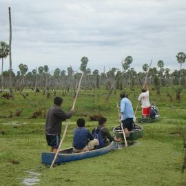 Local people searching the wetlands for yellow anacondas. Credit: Mariano Barros