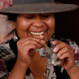 Chilean artisan working on a felted Andean cat Credit: Nicolás Lagos, AGA