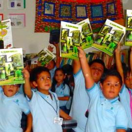 Environmental education at  school, using a colouring book made with the help of Defenders of Wildlife México. Credit: Claudia Cinta