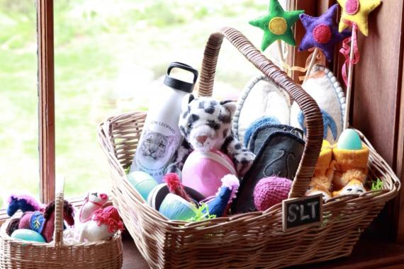 A selection of Snow Leopard Enterprises handicrafts in a wicker-basket